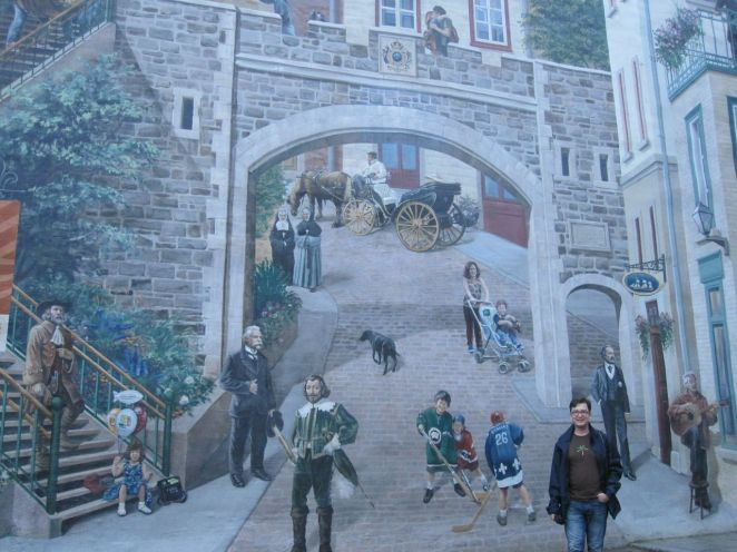 This mural in Old Quebec depicts life through the ages in that most magical of cities. Can you spot the tourist?
