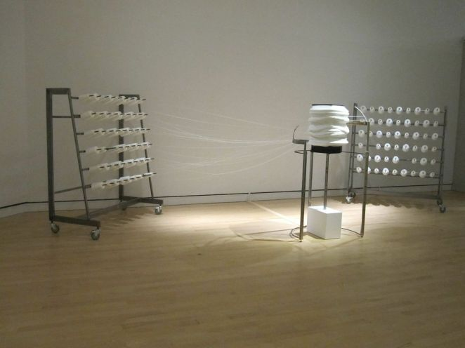 I love modern art, and I was very happy to visit the Musee National des Beaux Arts in Quebec. This photograph depicts a work of art that was on display. Basically, it's a rotating speaker pulling strings from spools mounted on a pair of racks. The speaker is playing music composed by the artist, Jocelyn Robert.